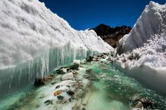Himalayas - India. Glacial melt water carving the ice.[3000x2000] photo by Sharada Prasad