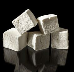 Adult Marshmallows    >>>>>>>>>>>>>>>>>    INGREDIENTS:  2 tablespoons Gelatin  1 cup Cold water  1.5 cups Granulated sugar  1 cup Corn syrup  .25 cup Liqueur (Crème de violette, Grand Marnier, Cointreau, Domaine de Canton)