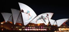 URBANSCREEN& mapping video projection onto the iconic building, part of the Vivid Sydney festival, had giant dancers climbing across its rippling sails.