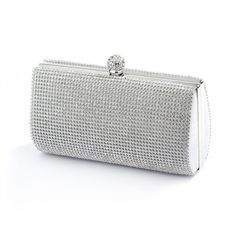 Bezel set crystals on front and back make this luxurious evening bag the perfect bridal clutch. A perfect size for all of your wedding day necessities, elegant and timeless. A sleek silver frame and b