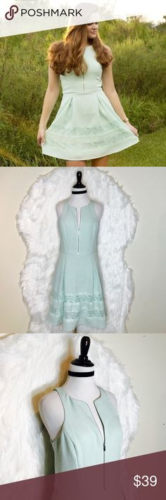 """Express Mint Pleated Lace Dress Express Lace Inset Fit & Flare Dress with Zip Front. It has pockets and side zipper to close. Front zipper is for design but is fully functional. Color is a mint green. Laid flat across @ bust: 17"""", Flat across @ waist: 15"""", Length: 34"""". NWO Express Dresses Mini"""