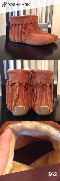 """NWOT Lucky suede moccasin booties NWOT - A beautiful pair of Lucky Brand suede moccasin booties.  These are great shoes!  Ankle-high booties with boho fringe all around the booties, hanging from the top.  Very thick, soft faux fur inside to keep your tootsies warm.  Very soft and cushion-like footbed for added comfort.  Rubber sole with non-slide """"nubbies"""" to keep you safe and secure.  Brand new without tags.  Never worn as you can tell from picture #4. Lucky Brand Shoes Ankle Boots…"""