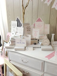 love the idea of using bureaus for display and then overstock is kept inside the drawers.