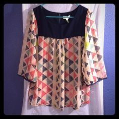 Adorable triangle top Oversized top with lace detail on sleeves. Needs a cami underneath. Fun pattern! Umgee Tops Blouses
