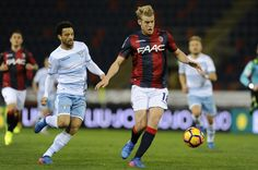 Felipe Andersonj of SS Lazio compete for the ball with Filip Helander of Bologna FC during the Serie A match between Bologna FC and SS Lazio at Stadio Renato Dall'Ara on March 5, 2017 in Bologna, Italy.
