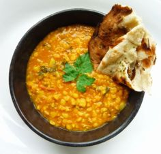 Yellow Split Pea Dahl:  2 c chana dal or yellow split peas  8c water   4 tomatoes, quartered  1/2c canola oil  1tsp cumin seeds  2tsp brown or black mustard seeds (opt)  10 cloves garlic, sliced   2 med yellow onion, finely chopped, and/or 1 or 2 hot green Thai or Serrano chiles, stemmed and halved lengthwise   1 1/2 tsp ground turmeric  2 tsp ground coriander  1 to 2 tsp cayenne (use the maximum if no fresh chiles are used)  1 to 1 1/2 tsp salt  2 tbs unsalted butter  6 tbs chopped coriander, leafy tops only