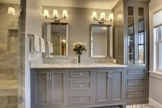 Creating the ultimate master bathroom design doesn't have to cost you a fortune. By using a few inside tips and tricks to getting the most out of your master bathroom budget space, you'll be sure to get a design you'll… Continue Reading → Trendy Bathroom, Bathroom Remodel Master, Bathroom Makeover, Master Bathroom Vanity, Amazing Bathrooms, Bathroom Colors, Grey Cabinets, Bathroom Design, Bathroom Decor