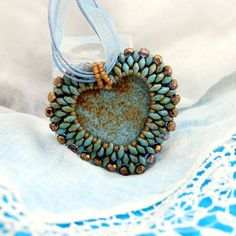 Super Duo Beads, stitched beads and seed beads on the felt.  5.5 * 5 cm