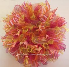 "Beautiful Summer Wreath has a mixture of oranges, yellows, and pinks and would look gorgeous on your front door, back patio, or porch. This wreath measure 24""."