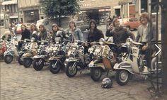 Vespas and Lambrettas, Mid-1970s, British scooter scene. Pennine scooter club Bradford outside Snowdens toyshop Skipton high street