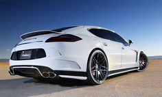 Porshe Panamera w/ Body Kit.  If I couldn't have the Galiber or the Rapide this would suffice:)