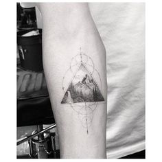 Fine line style mountain triangle tattoo on the right inner...