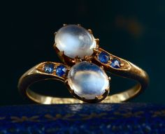 1913 English Edwardian Moonstone and Sapphire Crossover Ring