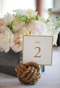 Create large knots from nautical rope to hold table numbers at your reception | Brides.com
