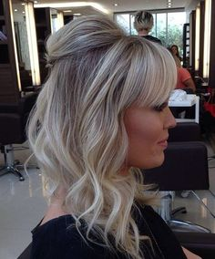 ash blonde hairstyle with bangs