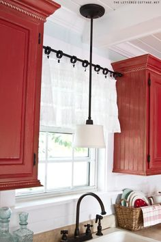 i LOVE the red cabinets! 8 ways to use tension rods:: Genius.I don't care about the tension rods, I LOVE the white walls with red cabinets! Hm Deco, Kitchen Window Curtains, Kitchen Windows, Picture Window Curtains, Window Shutters, Deco Champetre, Decorating Tips, Window Decorating, Rental Decorating