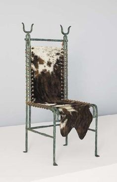 """ELIZABETH GAROUSTE AND MATTIA BONETTI """"Barbare"""" chair, ca. 1981  Patinated bronze, hide, leather. Manufactured by Néotù, France. One front foot impressed with manufacturer's mark, the other front foot impressed """"B.G."""" 46 in. (116.8 cm) high"""