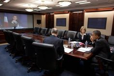 President Barack Obama participates in a video teleconference with President Nicolas Sarkozy of France, in the Situation Room of the White House