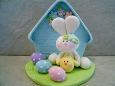 A sweet little bunny is holding a tiny chick. They have with them 3 polka dot Easter eggs.    This is an original design thats been