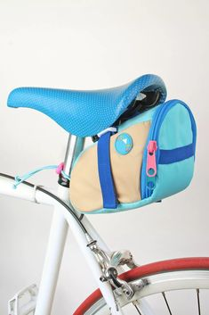 Mokuyobi Bike Seat Bag | Urban Outfitters Bike Seat Bag, Everyday Hacks, Cycle Chic, Baby Strollers, Urban Outfitters, Plush, Bicycle, Purses, Wallet