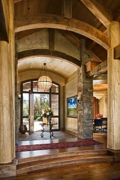 Simply sensational entryway, adore the arched wood beams  (via Montana - eclectic - living room - other metros - by Design Associates - Lynette Zambon, Carol Merica)