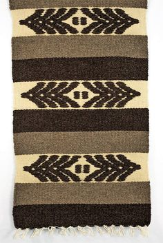 The Bulgarian production of household fabrics is characterized by a sustainable preservation of the tradition and the traditional symbols. In this rug, for example, the stylized image of the grain is present as the main focus of its design. Bulgarians used to put a bundle of wheat class as a symbol of fertility, life force and generosity of the Bulgarian land in the kitchen, where the whole family was gathering around the paralytic or the 'siniata' (a low table that is used without a chair…