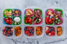 Grain free lunch. Cubes of cheddar and jack cheese, salami, tomatoes, cucumbers, strawberries, blueberries, raisins, apricots, and one has a boiled egg.