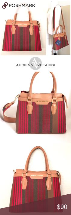 """Adrienne Vittadini Stripe Collection Tote Brand new with tags.An eye-catching striped design lends sophisticated style to this chic tote in tones of red and tan by Adrienne Vittadini. Crafted from quality faux leather (man made materials). Features dual rolled top handles; gold tone hardware; top zip closure; fully lined interior; 1 zip & 2 slip pockets inside; shoulder strap is removable but not adjustable. Measures 13""""W x 10""""H x 4.5""""D; handle drop is 7""""; shoulder strap drop is 21.5""""…"""