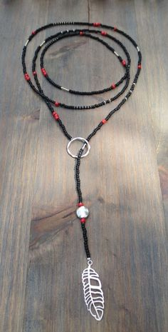Lariat in black and silver with a splash of red with Miyuki seedbeads and silver feather pendant. *Each lariat comes with our clip bead