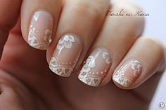 This is amazing! Lace nails instead of the traditional french tip :)