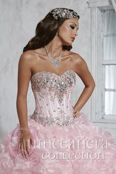 #Quinceanera Collection Style 26798: Gorgeous ball gown with a sweetheart neckline. Corset-style bodice with exquisite lace embroidery, sequins, and rhinestones. Skirt features large rosettes with center accent rhinestones. Lace-up back, sweep train.