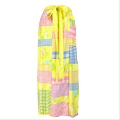 """VINTAGE 70s MR HANK PASTEL PATCHWORK MAXI SKIRT FEATURES: •Vibrant pastel patchwork of ginghams & florals w/ the words """"blueberries"""" & """"persimmons"""" written in white script •50% cotton/50% avril (rayon) •Ruched elastic waist w/ sewn-in yellow grosgrain tie belt •Straight cut •Pull-on - no closure •Lined in white muslin  CONDITION: Great NWT vtg condition w/ 1 tiny stain on front waistband (see last frame of 4th pic)  SIZE: Best estimated fit:XXS-XS  MEASUREMENTS: Waist:24-27"""" Hips:free…"""