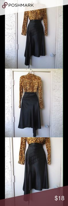 Glorious Black Dressy Skirt W/ Unique Front Detail This skirt is amazing. Gorgeous color and very beautiful design. Soft and comfy material. Size Large 13. Almost New. Save $$$ on bundles. Skirts Midi