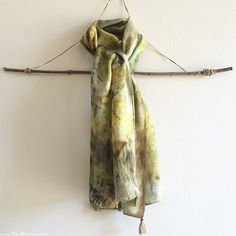This one of a kind silk scarf has been naturally dyed using plant colours and an…