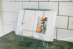 Could totally use one of these...Turquoise Cookbook Holder | The Magnolia Market