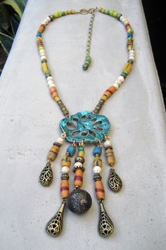 Long Tribal Necklace - African Asian Connection, Lost Wax Cast, Root of the Lotus Flower, Lotus Seed Beads, Colorful, Ethnic, Organic. $189.00, via Etsy.