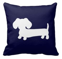 This little doxie will hang out all day on your sofa or bed keeping you company and comfy. Each pillow has a hidden zipper enclosure, is made of polyester and has a synthetic-filled insert. Size optio