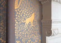 Handpainted walls. I'd do this in a dark, cool blue for the background, and silver for the design. I think it would work anywhere in the house, but I especially like the idea of it in my bedroom.