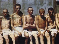 A group of inmates at Dachau concentration camp after liberation by the 42nd Rainbow Division and the 45th Thunderbird Division, 2nd May 1945
