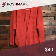 Cardigan Chunky cozy cardigan. Pumpkin coloring.  Oversized and so great for the colder months! 100% acrylic, 100% cotton. Comes in two sizes S/M ( fits 0-6)or M/L ( fits 6-XL) easel Sweaters Cardigans