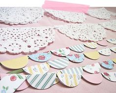 Bunting out of scrapbook paper circles and folded over then glued onto ribbon! genius! and so easy