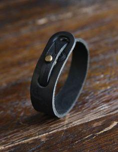 Adjustable black leather bracelet with metal rivet