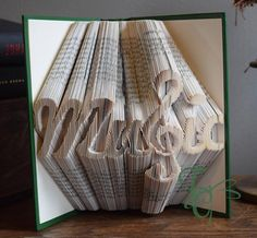 Folded Book Art  Music with Treble Clef  Book Sculpture