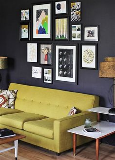 Bring out all your old and surplus wall hangings from the store room and create an artistic gallery wall for your living room. You can even gather the art from the internet by taking colored prints and framing them by the cardboard or simply pasting them in broken wooden frames.