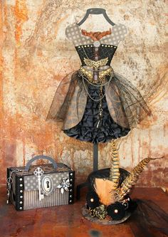 Graphic 45 Steampunk Debutante dressform by Maggi Harding with matching hat and mini altered suitcase. What a stunning scene! #graphic45 #steampunk