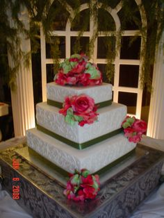 """Square 3 tier wedding cake - Square (13, 10, 7 inch) 3 tier wedding cake.  Silk hydrangea/roses on top and on tiers with ribbon borders... white cake inside with buttercreme icing... """"C"""" scroll design on sides of cake"""