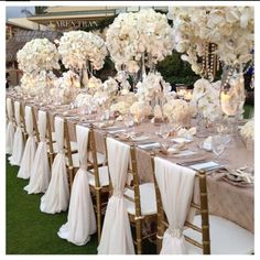 "Centerpieces, with less ""going on"" between the tall vases so guests can speak to one another"