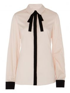 Bring an element of French minimalist chic into your wardrobe this  winter with the ALICE by Temperley Fitted Candy Shirt. Made of soft  cotton voile, a contrast trim button placket and neck tie pep up this  preppy yet sophisticated piece.           Fabric Composition: 100% cotton        Runs large in size, would suggest purchasing one size smaller.        Standard top length.        Model is 5ft 10 and is wearing a size 8.