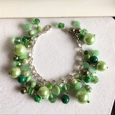 "Green Beaded Bracelet Pretty green multi-bead bracelet in silver tone chain with lobster clasp. Can fit up to size 8.5"" wrist. NWT. Jewelry Bracelets"