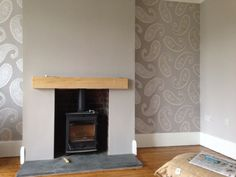 Very pleased with how our lounge has turned out. Wallpaper and paint all Laura Ashley.